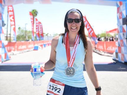 Corporate health and wellness program co-founder running a marathon.